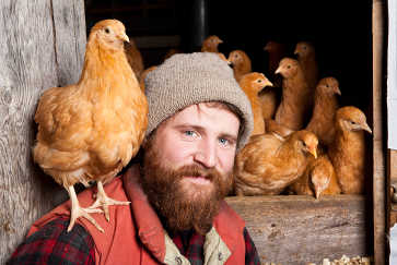 Portrait of Farmer with Chicken on Shoulder