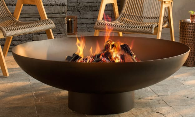 An Outdoor Fire Pit That Rests On The Outdoor Patio Is A Perfect Setting For Parties And Household Events