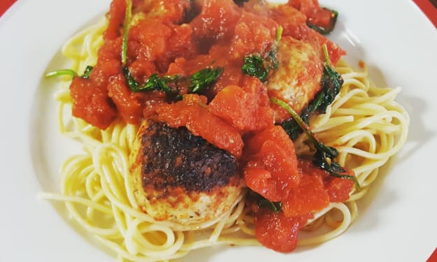 Chicken and Rosemary Meatballs with Sautéed Tomatoes and Spinach
