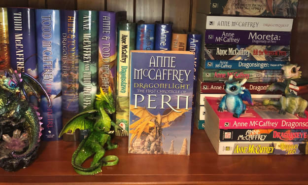 """A Guide to Reading Anne McCaffrey's """"Dragonriders of Pern"""" by Threadfall"""
