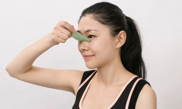 What does a Gua Sha do for your face?