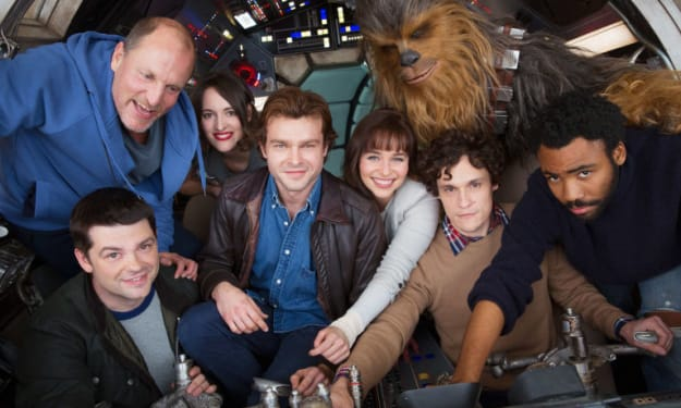 New Images From Han Solo Set Depict Aiden Ehrenreich and Woody Harrelson Meeting With Unidentified Character
