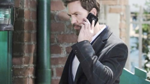 Who is on the other end of the telephone with General Hospital's Peter August