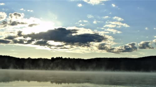 Early Morning Mist On A Mirrored Pond