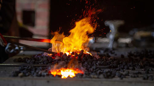 Red hot iron: Materials in a modern blacksmith's shop