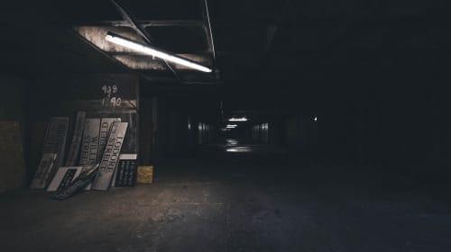 The Color of Dark People in Dark Rooms