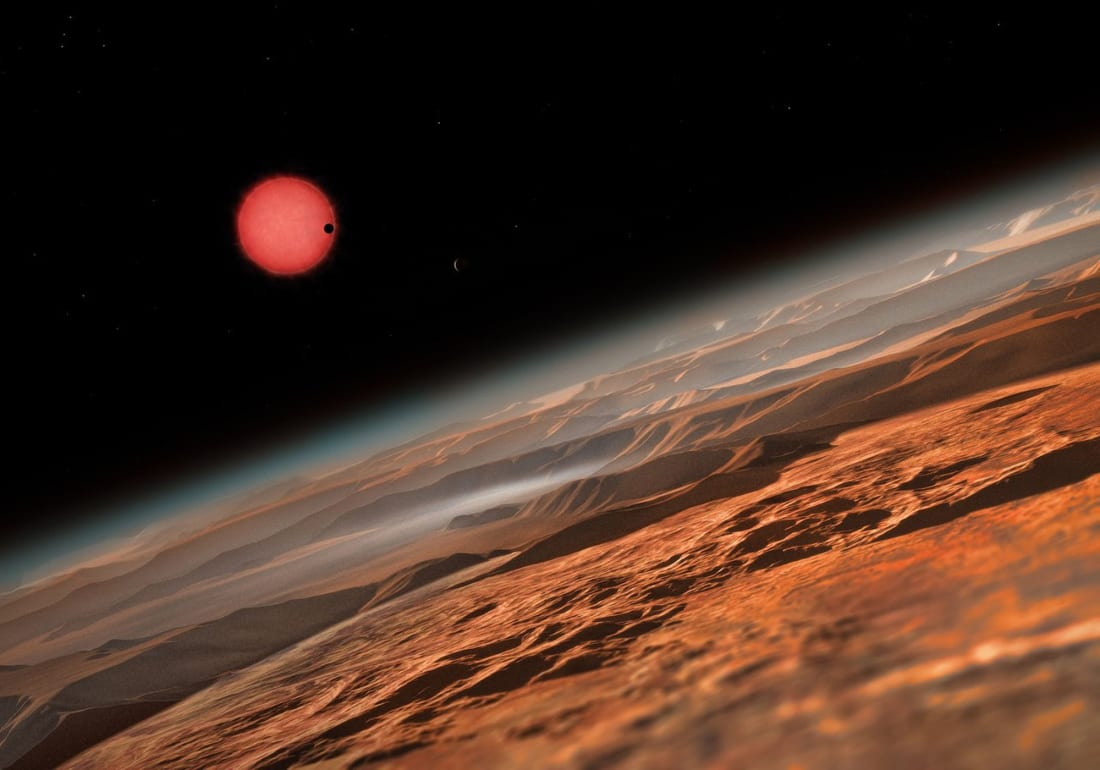 Artist's conception of the TRAPPIST-1 planetary system as seen from one of the seven Earth-sized planets. Image by ESO/M. Kornmesser