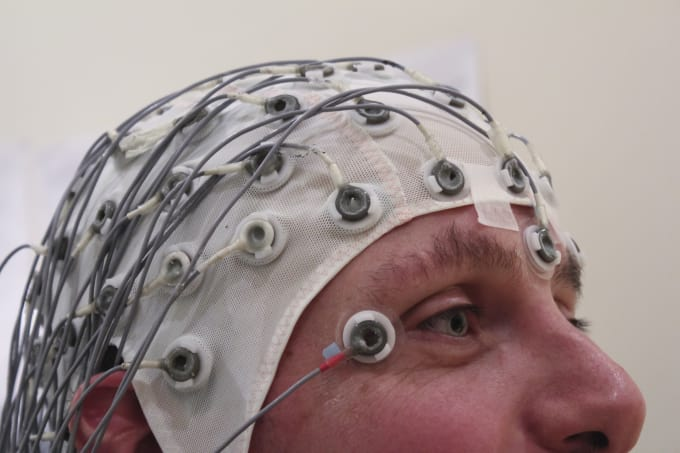 an EEG cap that records electrical impulses in the brain