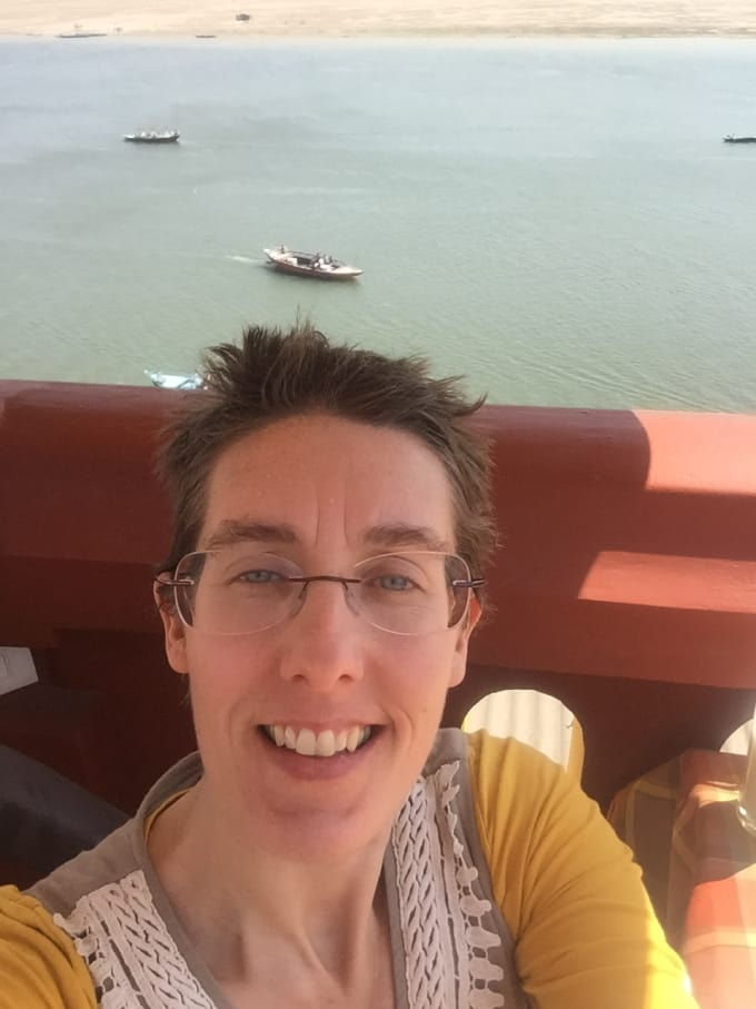 Suzanne in Varanasi, India in front of the Ganga.