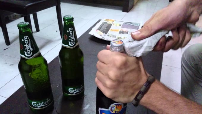 The Newspaper Bottle Opener