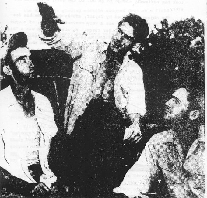 Elmer Sutton (Middle) describing the craft and creatures