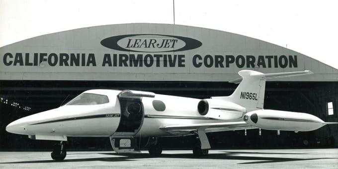 LearJet in front of hangar