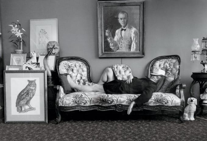 Capote lounging in his U.N. Plaza apartment