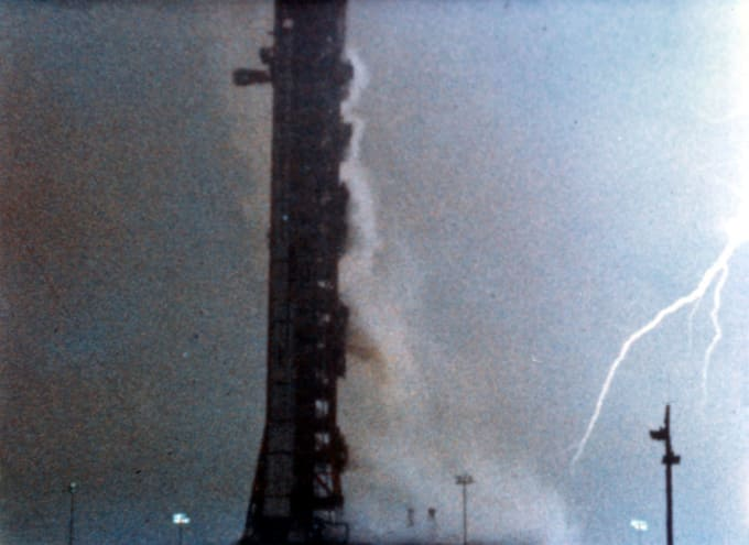 Lightning strikes around launchpad shortly after liftoff of Apollo 12. (Credit: NASA)