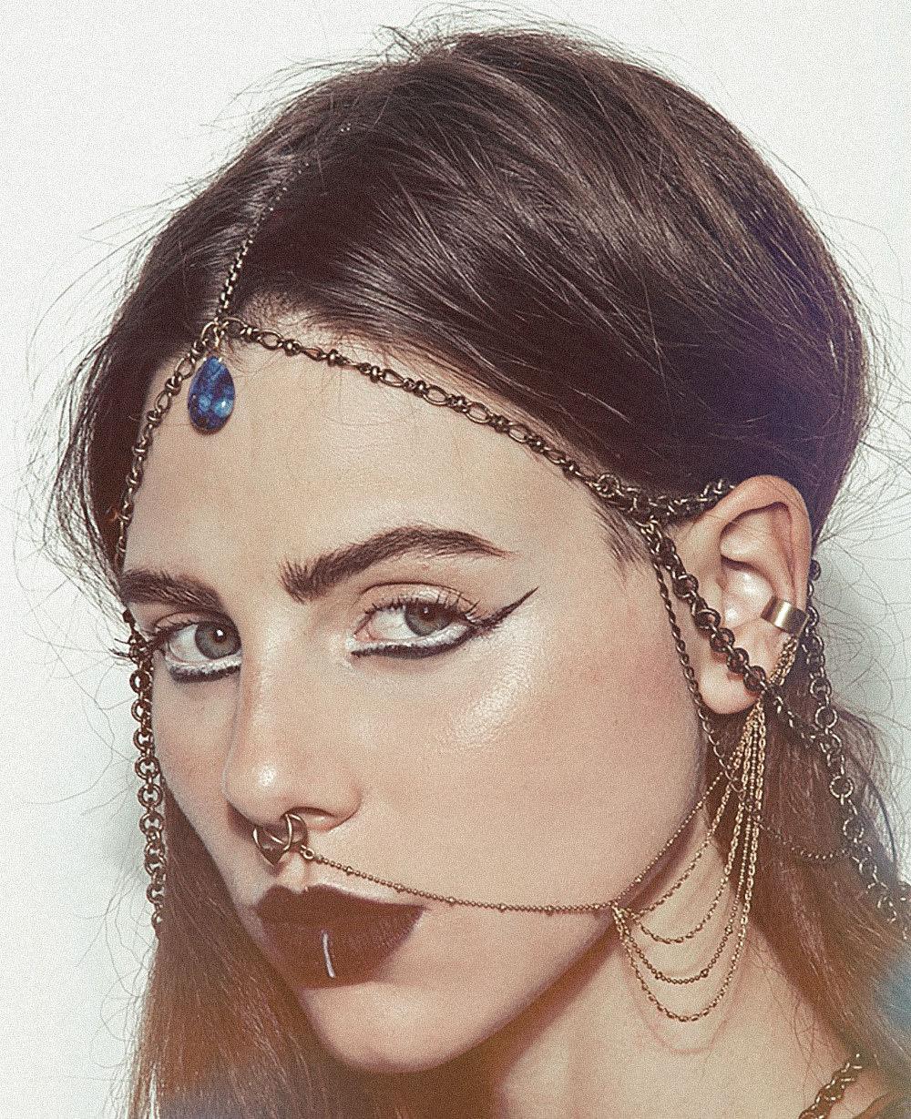Pornstar multiple ear piercing