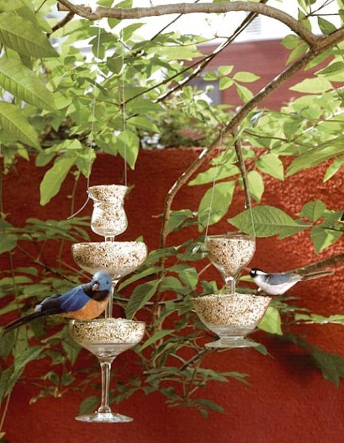from the absolute best wine glass decorating ideas ever is this wine glass bird feeder you can now properly recycle and give back to nature by using your