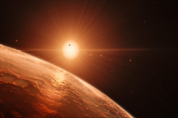 Three Potential New Earths Found in a Planetary System of Seven