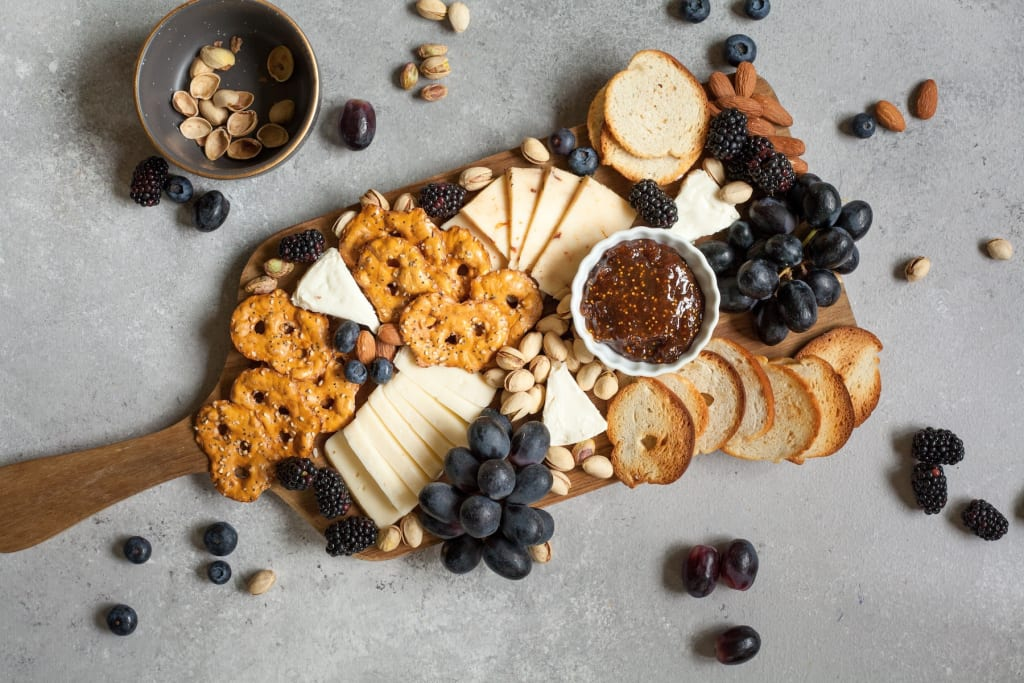 How To Create the Perfect Cheese Board for Your Next Party