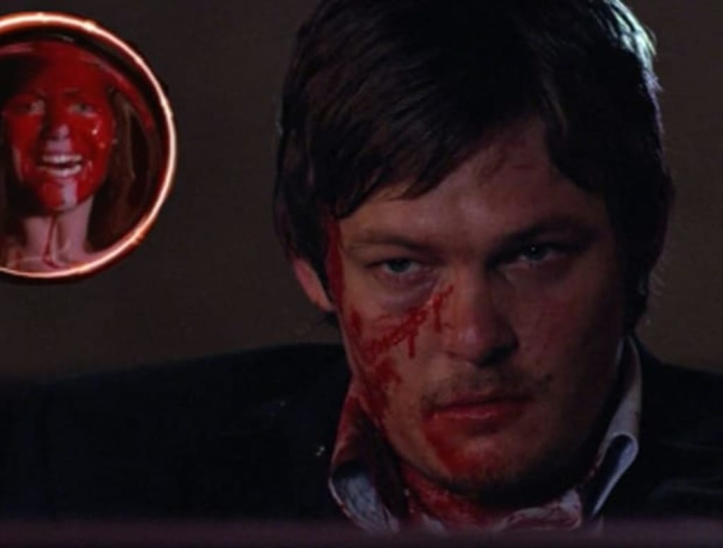 Before 'TWD,' Norman Reedus Faced Horror in John Carpenter's 'Cigarette Burns'