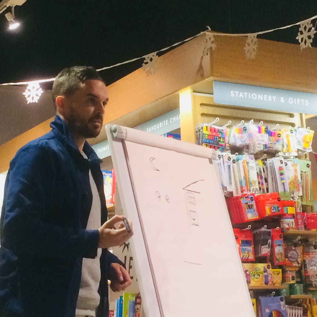 Oliver Jeffers Signing Copies of 'Here We Are'