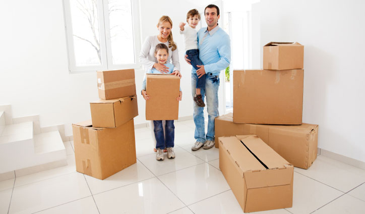 family with the packing boxes