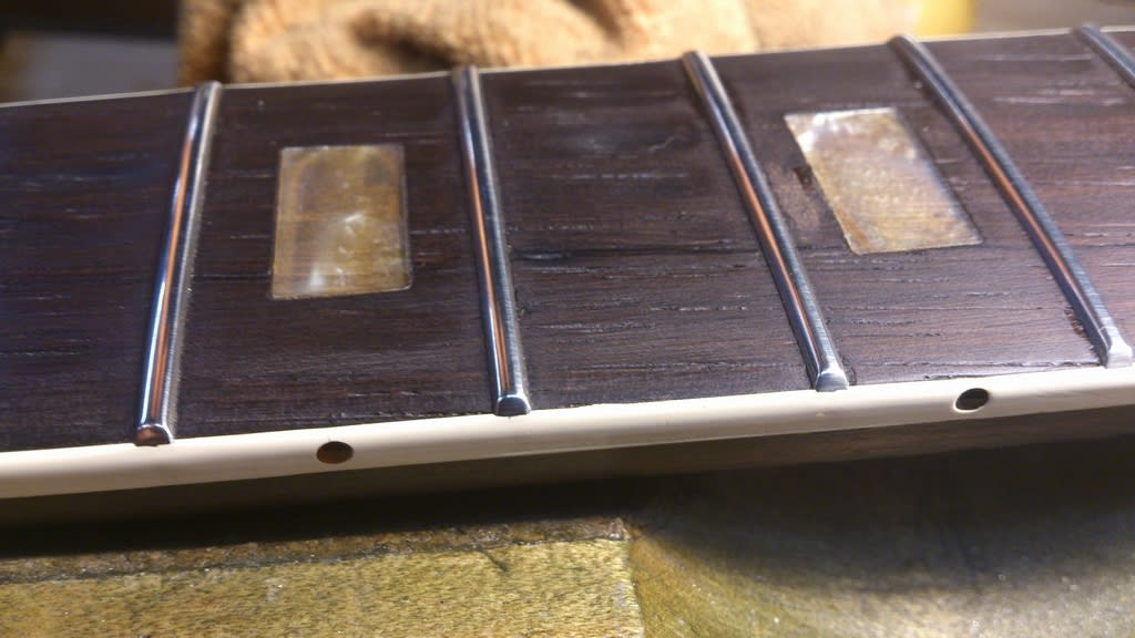 Just a closeup of our finish on the fretends of the new frets...and another chance to checkout the translucent fret markers