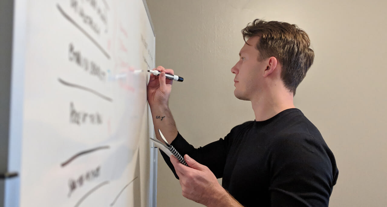 Nate at the whiteboard.