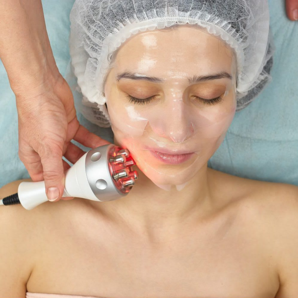 Young woman wearing collagen mask.