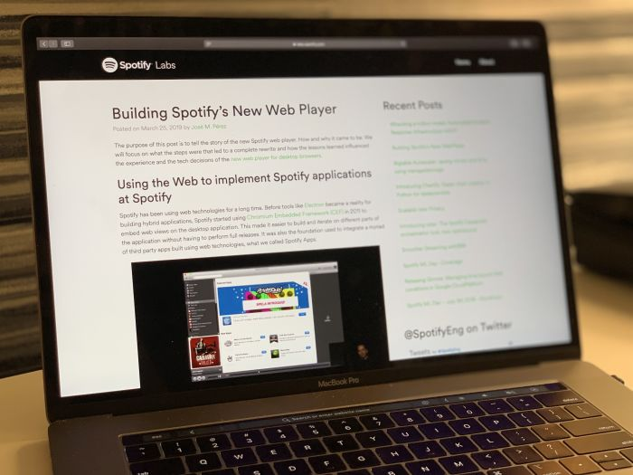 A picture of a laptop showing Spotify's Web Player