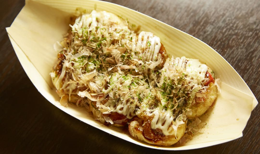 takoyaki in a bowl on a table