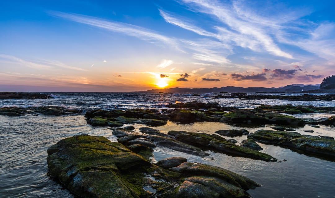 Rocky shoreline along Shimoda beach near Tokyo for a beach break