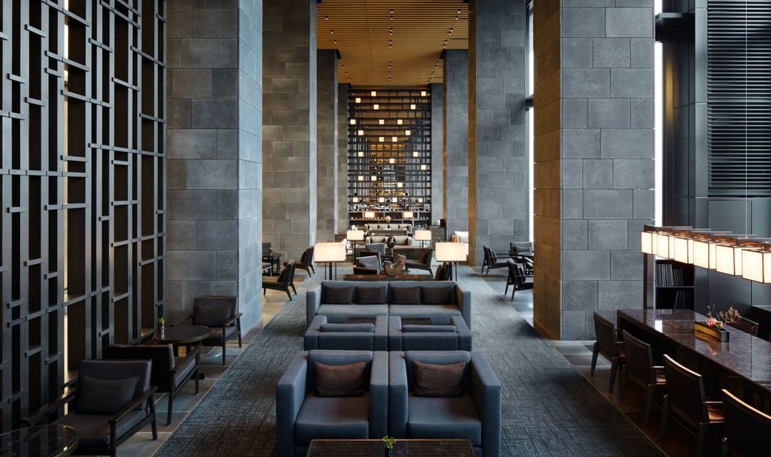 a hotel lounge with grey sofas