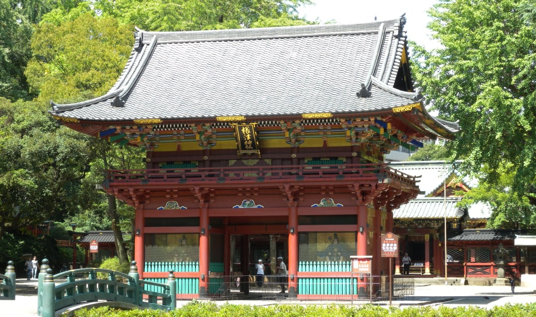 a big shrine gate surrounded by trees