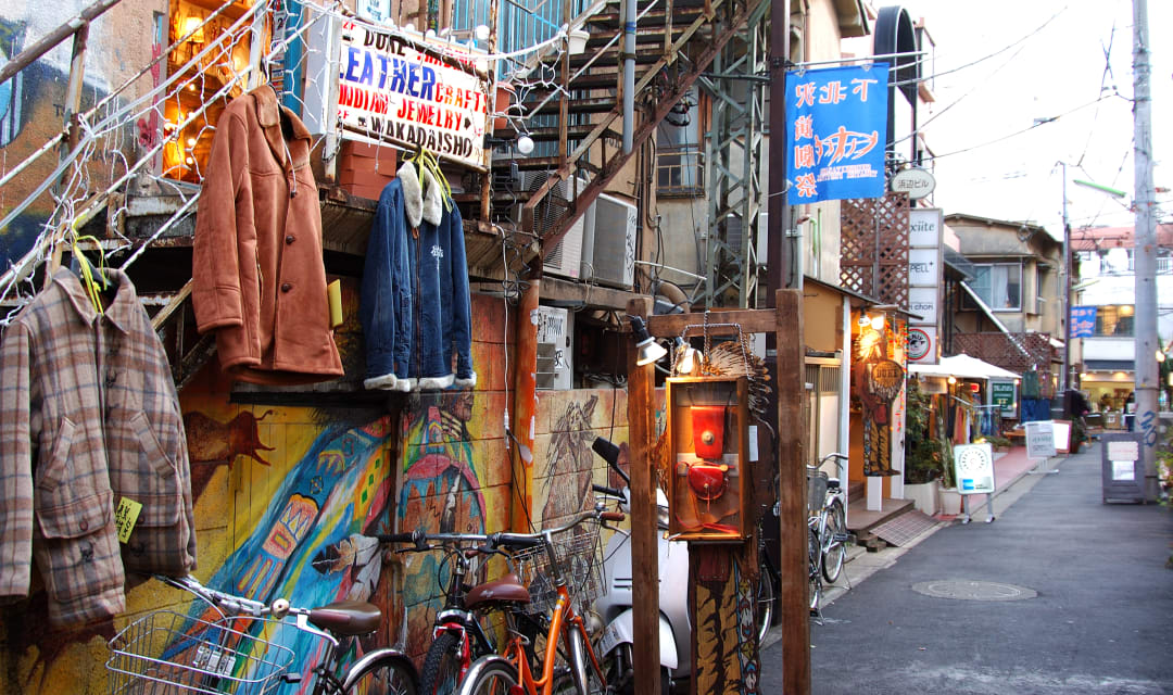 the outside of a shop with jackets on display