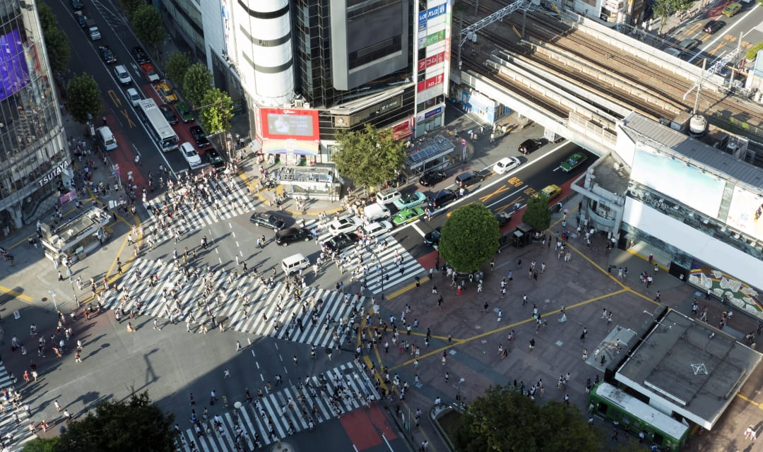 a shot of a busy pedestrian crossing shot from above