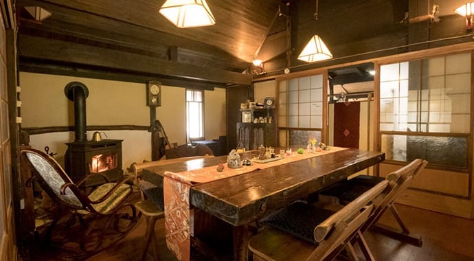 The dining room, beautifully restored and heated by a wood-burning stove.