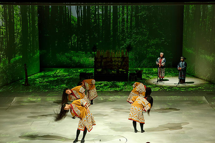 During the traditional dance, performers swing their long black hair to evoke pine trees swaying in a storm.