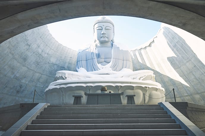 Visitors pass through a tunnel to reach the Great Buddha.