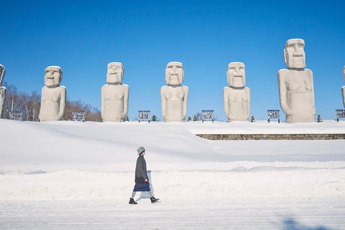 Moai statues line the main entrance to Makomanai Takino Cemetery.