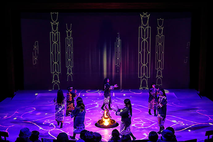 """A scene from """"Lost Kamuy,"""" using fire, dance and digital effects."""