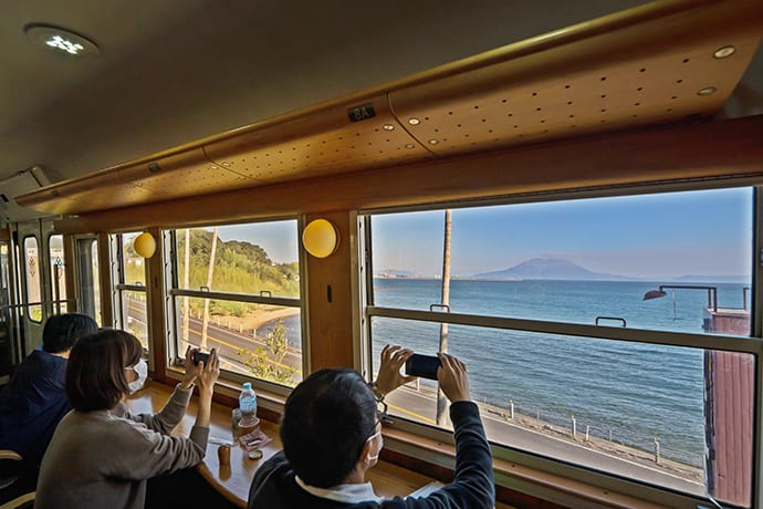 The island of Sakurajima with its impressive volcano, is clearly visible from the train. The volcanic island is 15 minutes by ferry from Kagoshima's port area.
