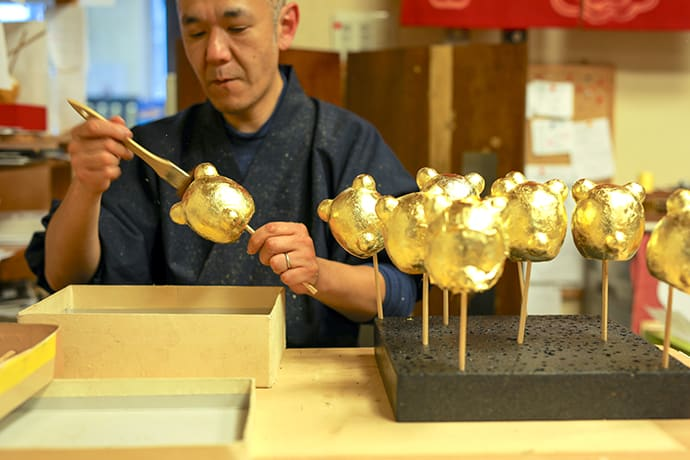 To prevent wasting gold leaf, it is applied without overlap.