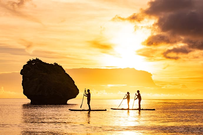 A SUP experience at sunset. Hoshino Resorts Iriomote Hotel offers a range of programs for its guests