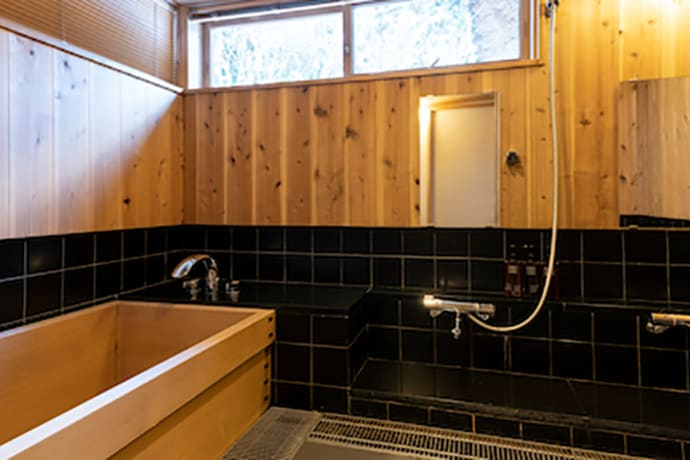 In addition to a bathroom with a cypress tub, there is a shower room as well.