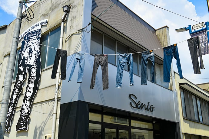 Pairs of jeans hung over Jeans Street