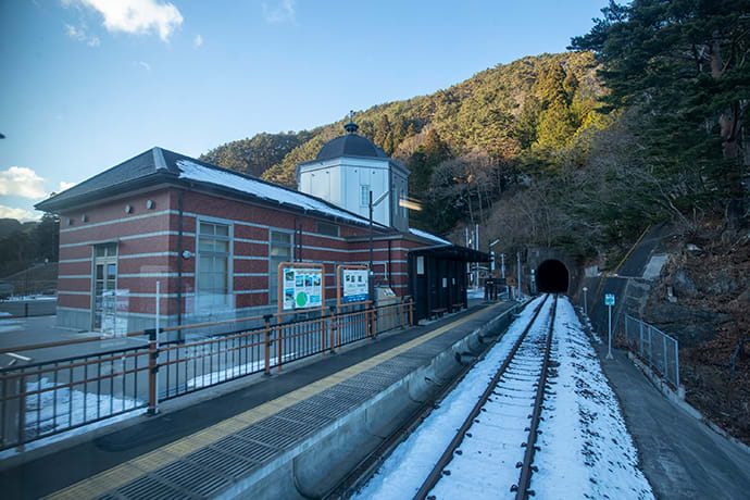 Pictures from before the disaster are on display on the platform at Shimanokoshi Station.