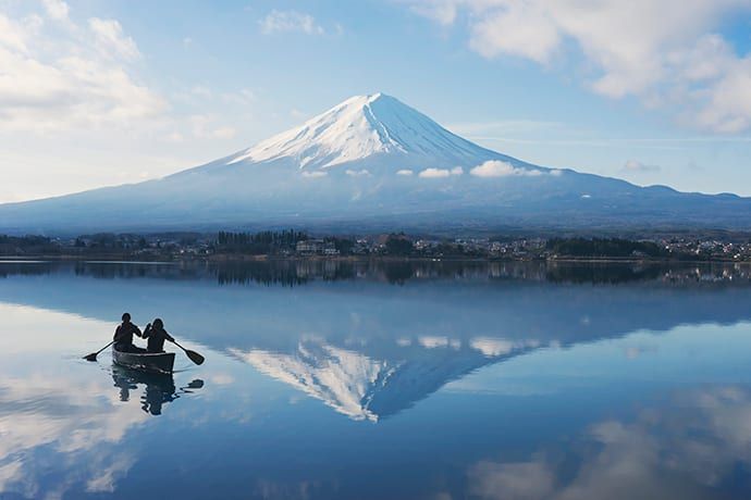 Canoeing on Lake Kawaguchi. On clear days, Mt. Fuji is reflected in the water.