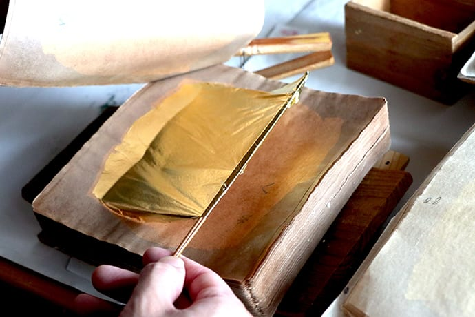 Gold leaf that has been hammered to a thickness of just 1/10,000 of a millimeter (0.1 microns).