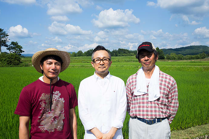 Rice farmers from Goto Farm pose with Chef Hiraki (center). Goto Farm rice was deemed high enough quality to be served to the emperor.
