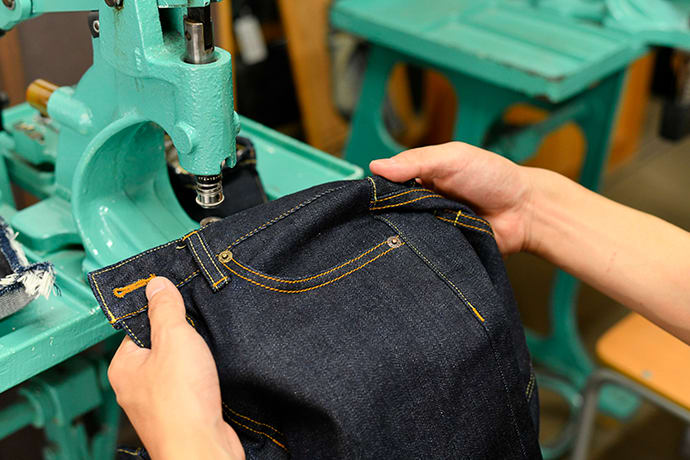 Some denim artisans still use pedal-driven machines. Children can operate one, too, if supervised by an adult.